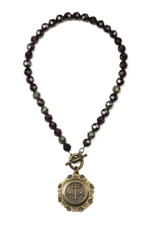 FACETED GARNET WITH LA JEANNE MEDALLION
