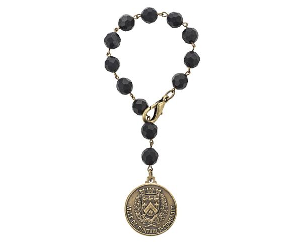 FACETED BLACK ONYX WITH BRASS WIRE AND VOYAGEUR MEDALLION