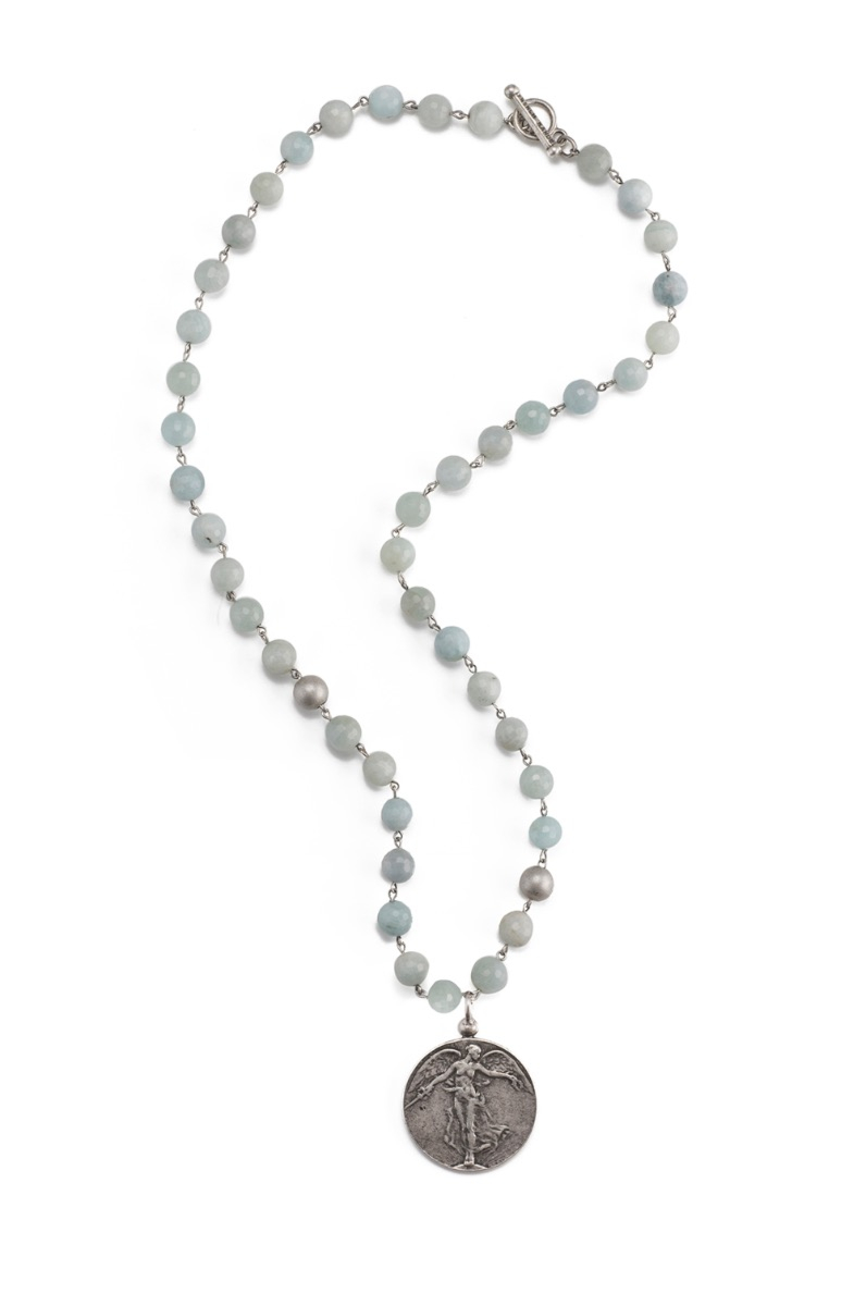 FACETED AQUAMARINE WITH SILVER WIRE AND L'ANGE MEDALLION