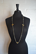 FACETED GREY LABRADORITE WITH BRASS WIRE, MIEL PENDANTS AND X MEDALLION