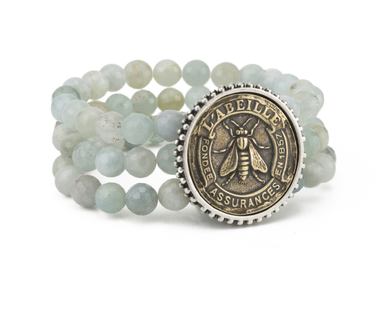 TRIPLE STRANDED FACETED AQUAMARINE WITH ABEILLE MEDALLION