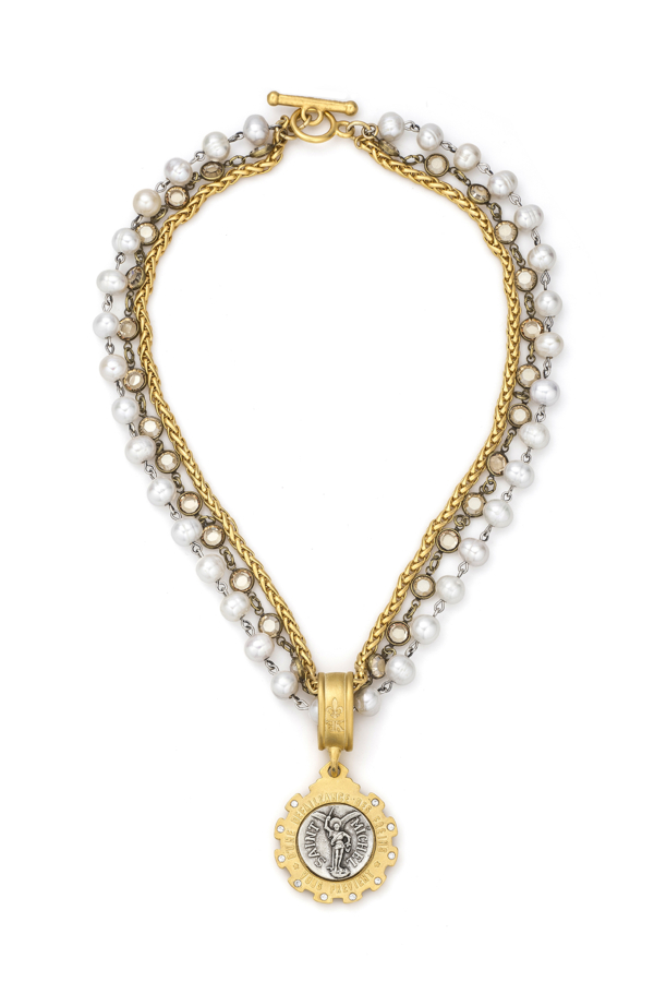 TRIPLE STRANDED WHITE PEARLS WITH SILVER WIRE, PETITE CHEVAL CHAIN, GOLDEN SHADOW SWAROVSKI AND MINI SAINT MICHEL MEDALLION